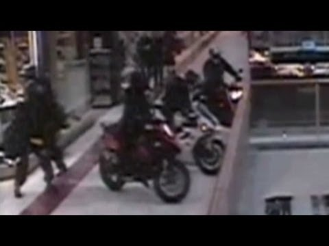 Raw video: Motorbike gang drives through mall, robs store