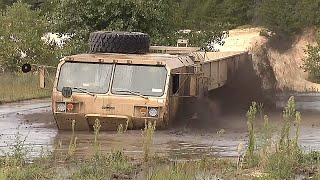 STUCK in THE MUD! How to recover a MULTI-MILLION-DOLLAR military vehicle with a M984 WRECKER!