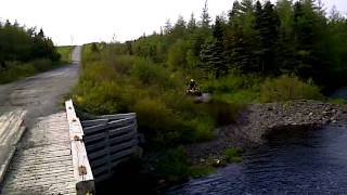 atv 800 can am floating  in nl river.3GP