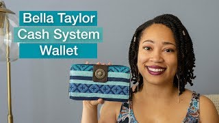 This is the Bella Taylor cash system wallet. This wallet has divide...
