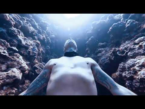 Freediver Jumps Down Deep Canyon Holding His Breath