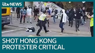 Hong Kong protester shot by police in critical condition | ITV News
