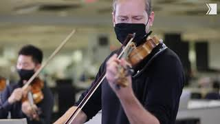 Concertmaster Jonathan Crow leads nine TSO musicians in performance at the Toronto Star newsroom