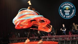 SPOTLIGHT - Most hula hoops spun simultaneously