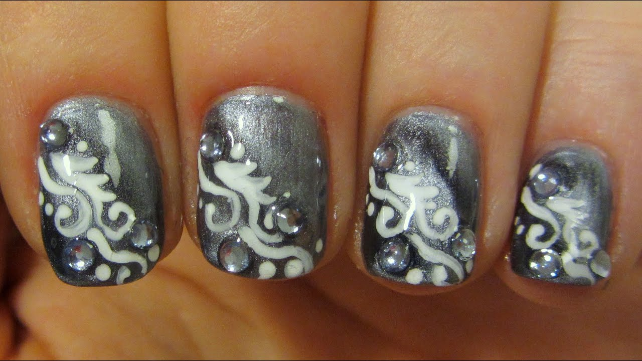 Magnetic Grey and White Swirly Design on Short Nails with Icy Blue ...