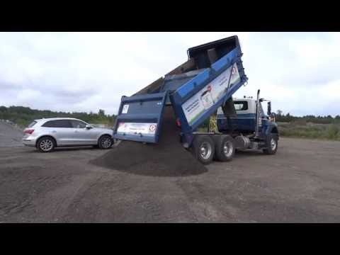 Greely Sand & Gravel unloading a full tandem load of crushed stone (16 metric tonnes)