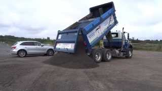 greely sand gravel unloading a full tandem load of crushed stone 16 metric tonnes