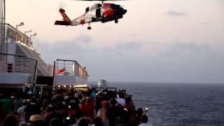 Carnival Liberty Cruise US Coast Guard Helicopter Rescue 09 March 2012 - basket drop & pull up