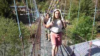 Suspension Bridge And Tourists In Marsyangdi River