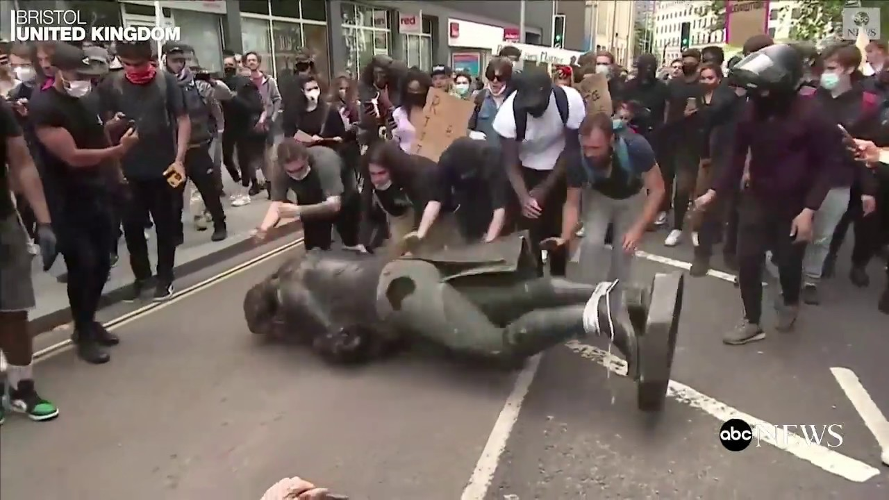 Protesters in UK tear down 17th century slave trader's statue