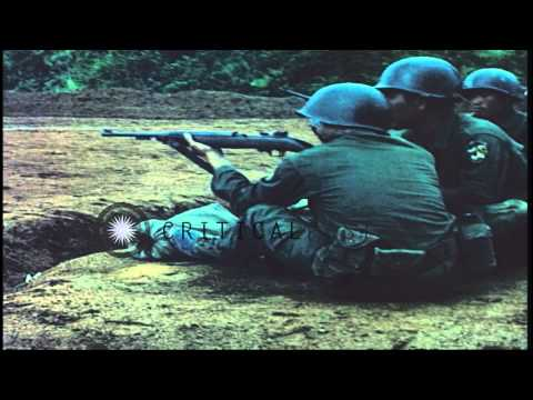ROK (Republic of Korea) Tiger Division soldiers fire 105mm howitzer and rifles on...HD Stock Footage
