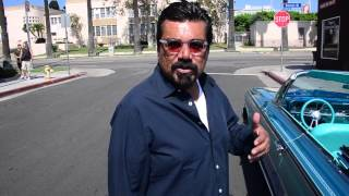 George Lopez cruises in a 1962 Chevy Impala Low Rider for the Los Angeles Unified School District