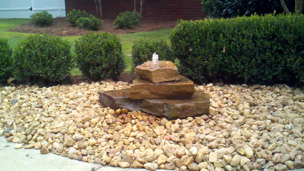 bubbling rock water feature everything green landscaping
