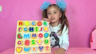 Dominika play with funny alphabet toys