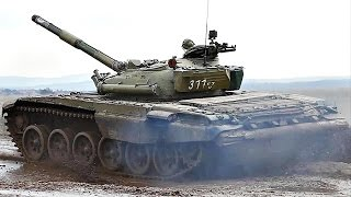 strykers and t 72 tanks play in the mud slow mo video