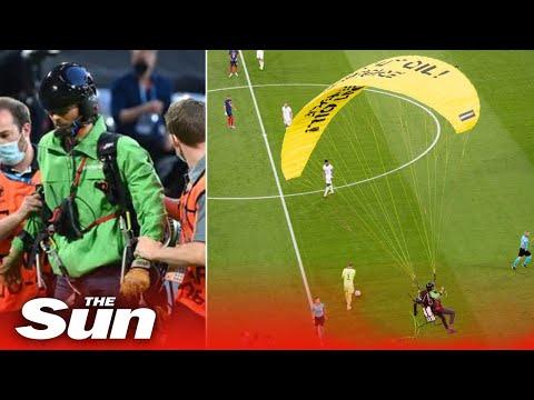 Parachute protester crash lands into Euro 2020 game hospitalising football fans