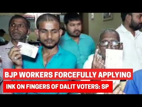 BJP workers forcefully applying ink on fingers of Dalit voters in UP's Chandauli: SP