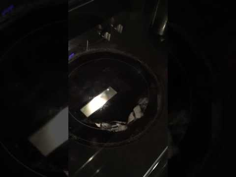 Cleaning off burnt cloth on stove top