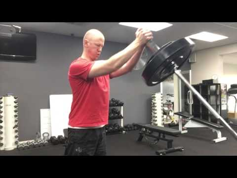 Landmine chest press standing
