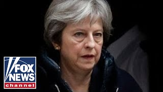 British Prime Minister Theresa May vows a 'full and robust response...