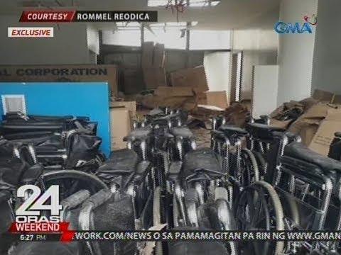 24 Oras: Marurumi at nabasang wheelchairs daw ng DOH, nakatambak sa Philpost office