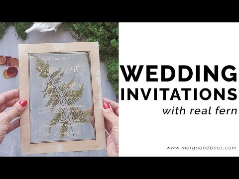 Rustic wedding invitations with real fern