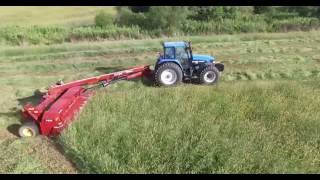New Holland TM165/New Holland 1431 Mowing