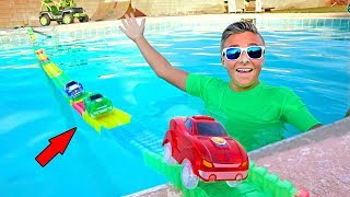 One of Carl & Jinger Family's most viewed videos: Giant Magic Tracks Swimming Pool Bridge Adventure!