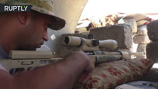 RAW  Iraqi Army snipers coordinate with police units in fight for Mosul