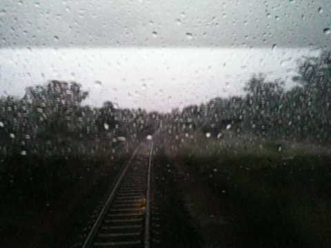 Freight train driving through electrical storm (in cab)