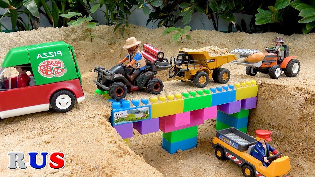 Построить мост с грузовик, экскаватор, трактор, мусоровозы. видео для детей