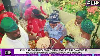KUNLE AFOLAYAN DOLES OUT CASH TO CULTURAL DANCERS AT YOUNGER BROTHER, GABRIEL AFOLAYAN'S WEDDING