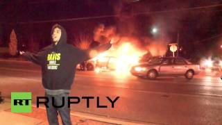 USA: Ferguson police car BURNS as violence flares