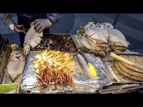 Grilled Squid and Deep-Fried Shrimps, Octopus, Crabs. Korea Street Food. Myeongdong, Seoul