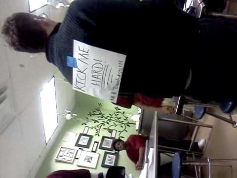KICK ME SIGN ON TEACHER'S BACK