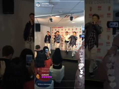 "In Real Life performing ""Eyes Closed"" for their fans"