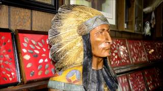 Charles Griffin Shows Wooden Indians Carved By A Canadian Tribe