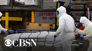 U.S. surpasses 14 million coronavirus cases as country awaits vaccine approval