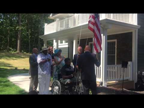 Wounded Marine raises flag at his new home in Fauquier County, Va.
