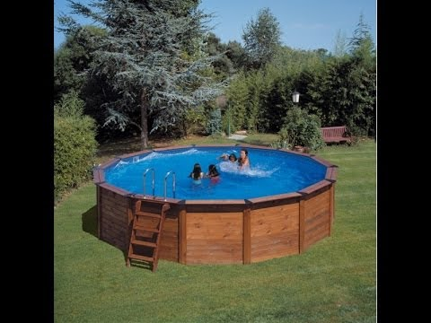 Installation piscine hors terre bois ronde youtube for Amenagement piscine hors sol photo