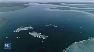 Baixar China's largest inland saltwater lake begins to thaw