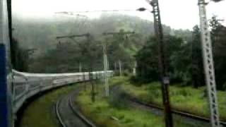 12542 LTT  GKP Superfast Train Hybrid touching the sky and clouds on kasara