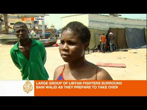 Dark skinned people in Libya say they suffer at hands of fighters