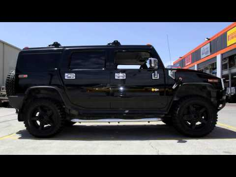Hummer H2 with custom rims 20 inch KMC Rockstar XD 2 Maxxis MT762 Tyres