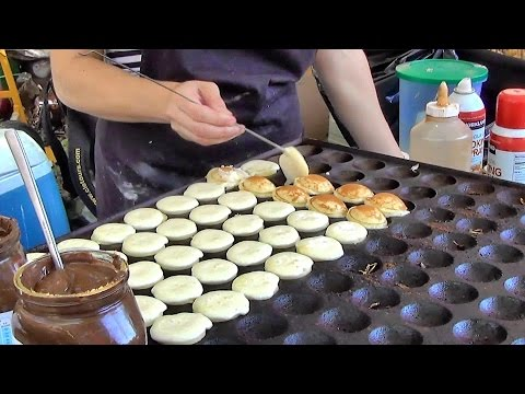 "London Street Food. Cooking Sweet Dutch Pancakes ""poffertjes"" in Camden Lock Market"