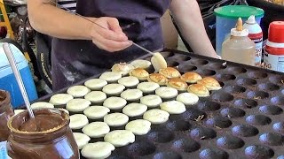 London Street Food. Cooking Sweet Dutch Pancakes