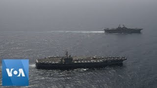 US military ships carry out joint operations in the Arabian Sea