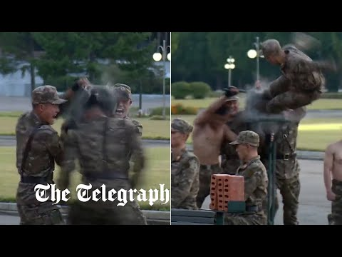 North Korea: Troops break bricks with bare hands in bizarre show of force