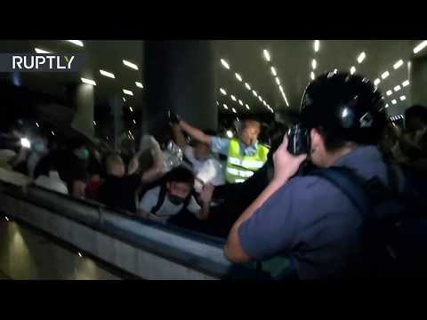 Protesters clash with police over extradition bill as 'over 1mn people' march in Hong Kong