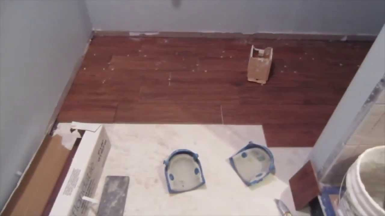 How to install a wood look porcelain plank tile floor - YouTube